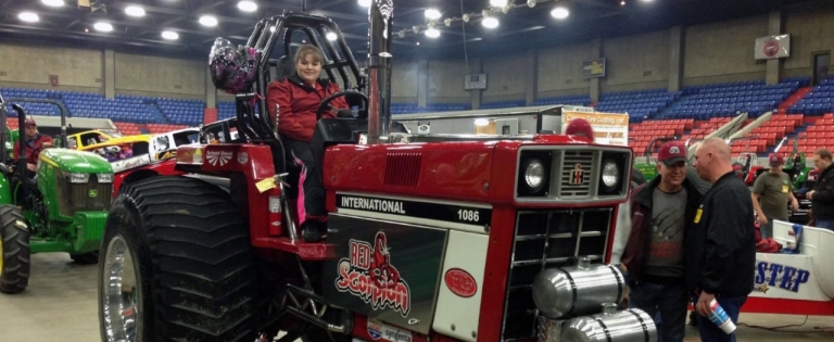 Brooke Darnell atop her tractor 'Red Scorpion'
