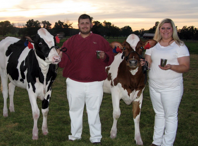 Billy Cameron and Celia Thomas with their champion heifers