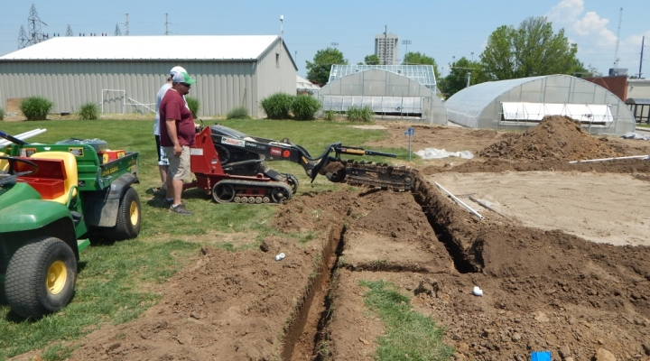 John Duvall and Alex Chandler digging irrigation lines for the water conservatio